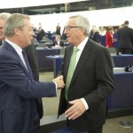 Handshake between Nigel Farage, Member of the EP, and Jean-Claude Juncker (in the foreground, from left to right)